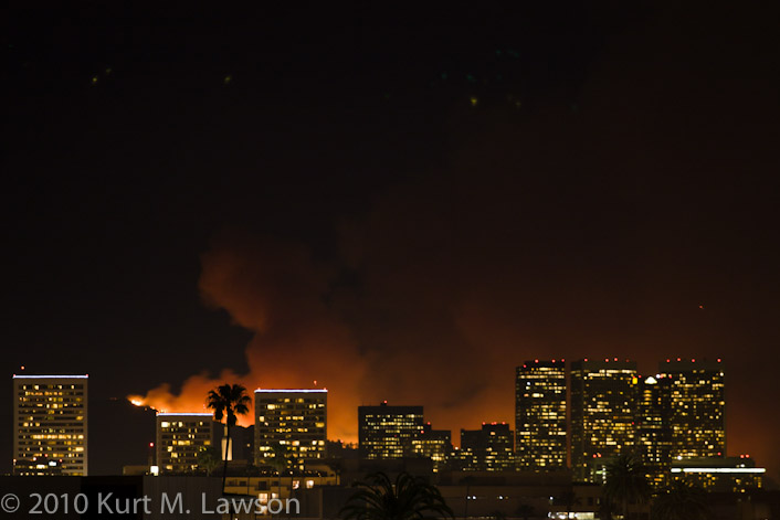 Griffith Park fire gives an apocalyptic glow behind the buildings of Century City