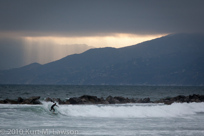 Surf's up under the god rays