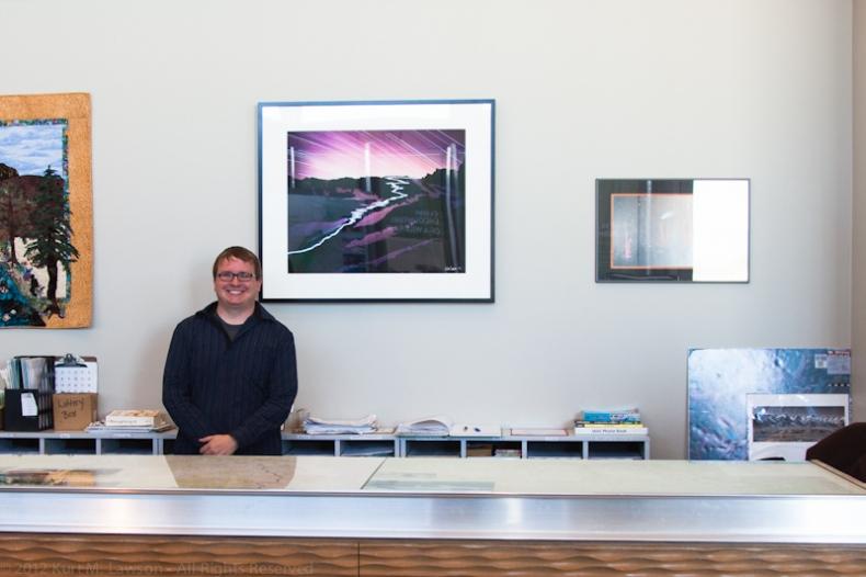 Kurt stands next to his photo