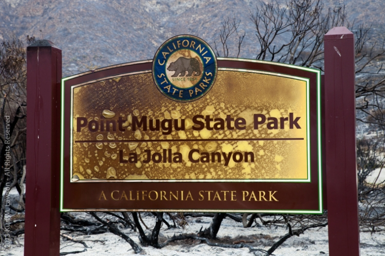 Pt. Mugu Stata Park sign now with added character